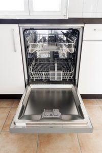 Empty Opened Dishwasher in kitchen (vertical edit)